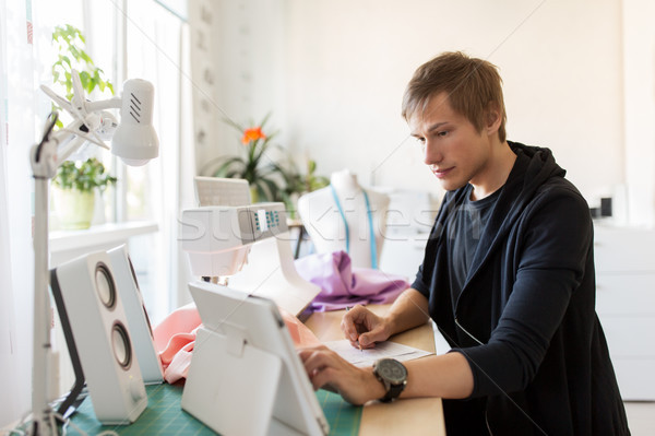fashion designer with tablet pc working at studio Stock photo © dolgachov