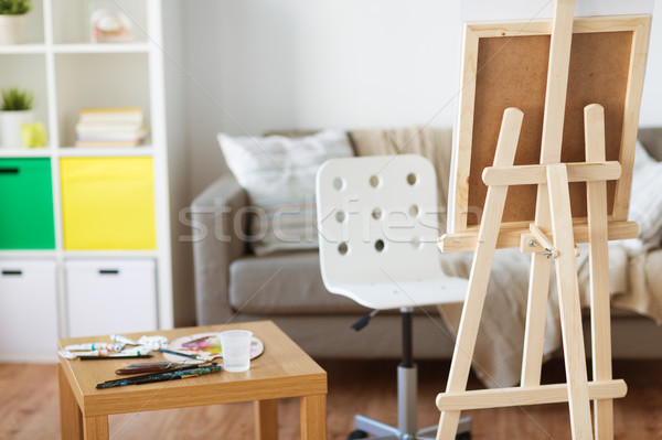 easel and artistic tools at home or art studio Stock photo © dolgachov