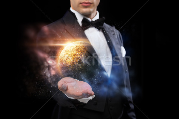 male magician with planet and space hologram Stock photo © dolgachov