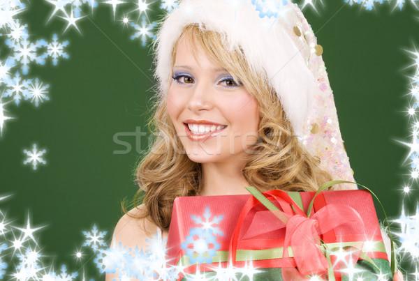 happy santa helper with gift box Stock photo © dolgachov