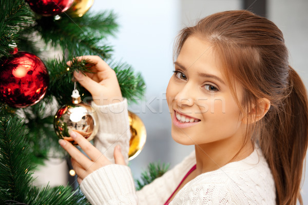 woman decorating christmas tree Stock photo © dolgachov