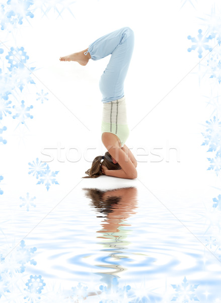 Stock photo: salamba sirsasana supported headstand on white sand