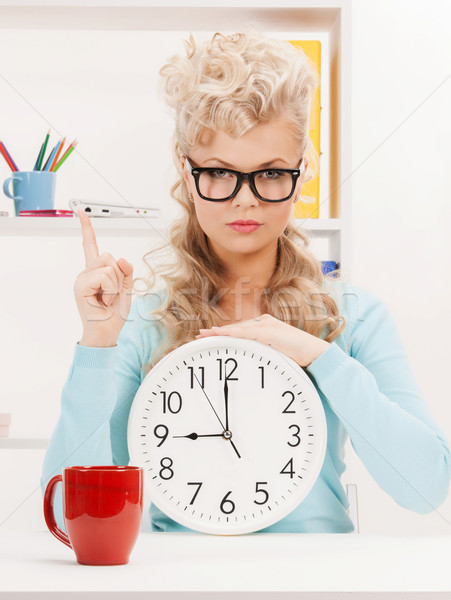 businesswoman with clock and finger up Stock photo © dolgachov