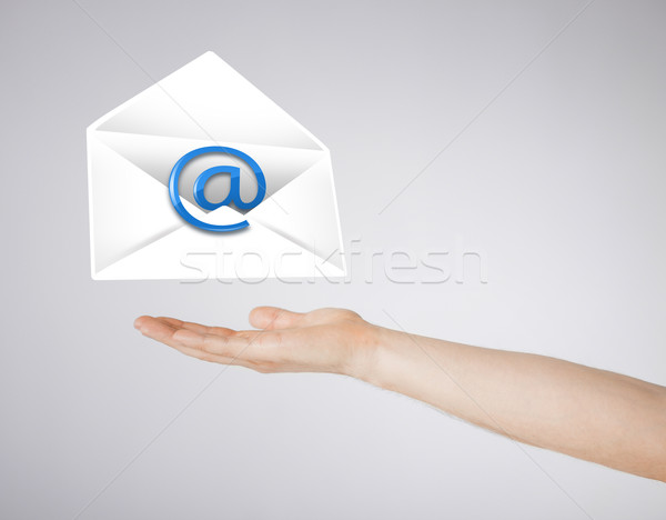 hand holding envelope with email sign Stock photo © dolgachov