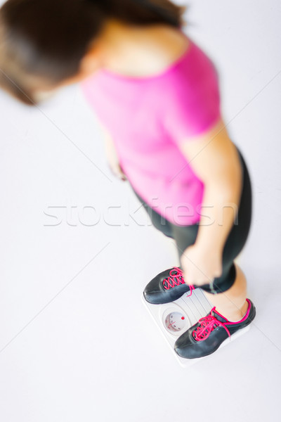 woman legs standing on scales Stock photo © dolgachov
