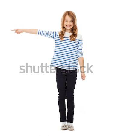 Aranyos kislány mutat oldal oktatás iskola Stock fotó © dolgachov