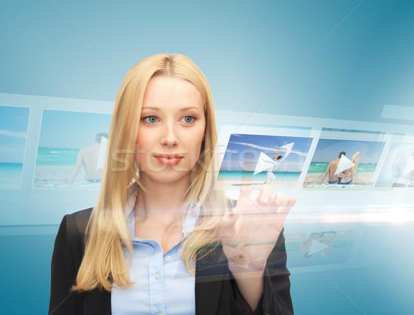 businesswoman with virtual screen Stock photo © dolgachov