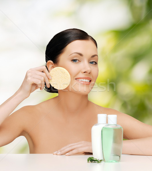 Stock photo: smiling woman with sponge