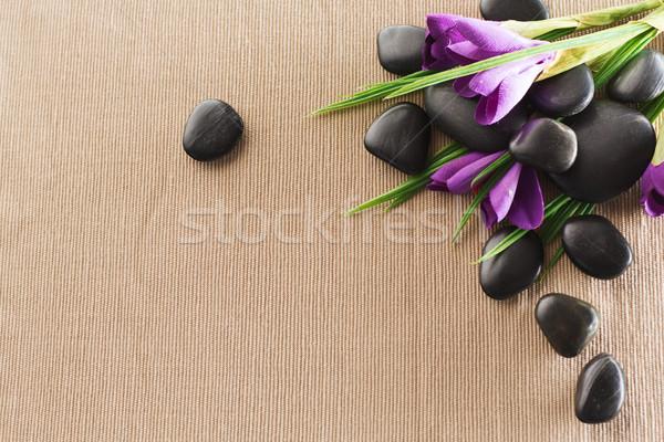massage stones with flowers on mat Stock photo © dolgachov