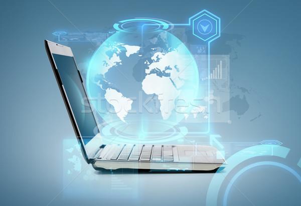 Laptop számítógép földgömb hologram technológia hirdetés internet Stock fotó © dolgachov