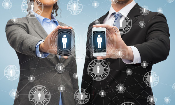 Affaires femme d'affaires smartphones affaires technologie sociale Photo stock © dolgachov