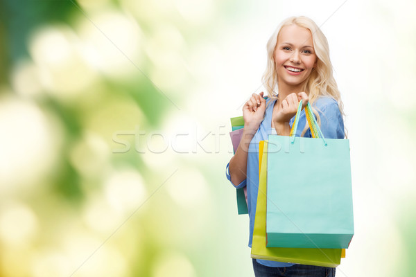 smiling woman with many shopping bags Stock photo © dolgachov