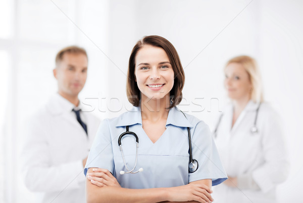 young female doctor with stethoscope Stock photo © dolgachov