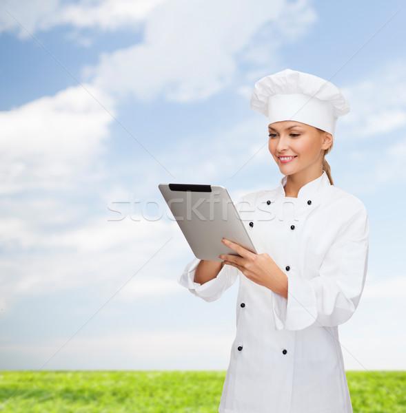 Mosolyog női szakács táblagép számítógép főzés Stock fotó © dolgachov