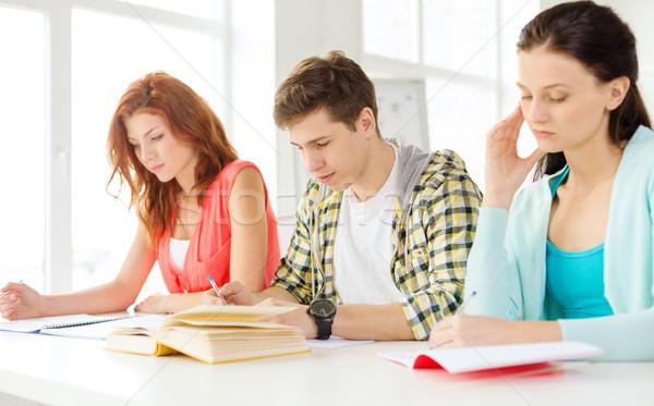 Fáradt diákok tankönyvek könyvek iskola oktatás Stock fotó © dolgachov