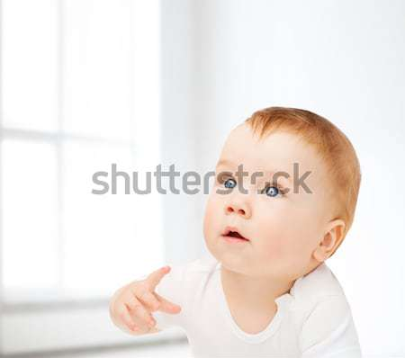 smiling baby lying on floor and looking up Stock photo © dolgachov