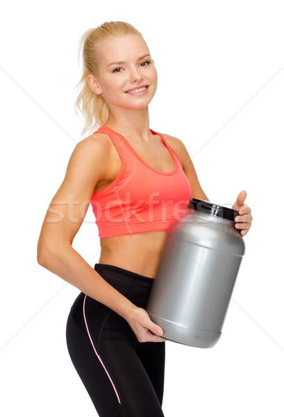 Glimlachend vrouw jar eiwit fitness Stockfoto © dolgachov