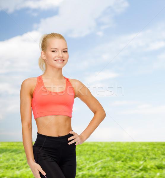 Gyönyörű sportos nő sportruha fitnessz sport Stock fotó © dolgachov