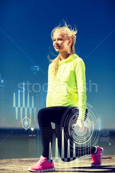 Sportos nő fény súlyzók kint sport Stock fotó © dolgachov