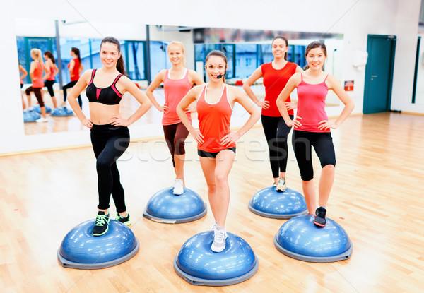 Csoport női aerobik fél labda fitnessz Stock fotó © dolgachov