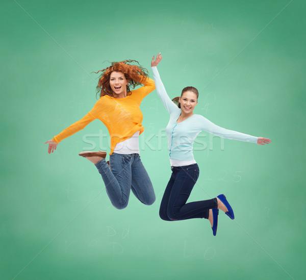 Foto stock: Sorridente · mulheres · jovens · saltando · ar · felicidade · liberdade
