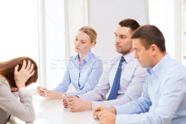 businesswoman getting fired in office Stock photo © dolgachov
