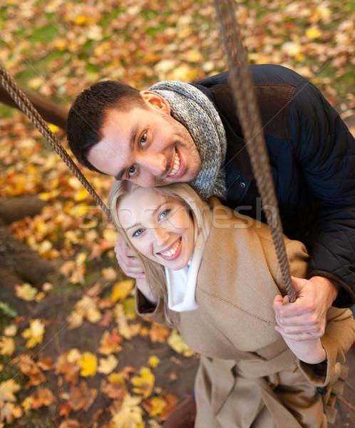 Sorridere Coppia autunno parco amore Foto d'archivio © dolgachov