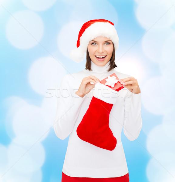 Nő mikulás kalap ajándék doboz harisnya karácsony Stock fotó © dolgachov