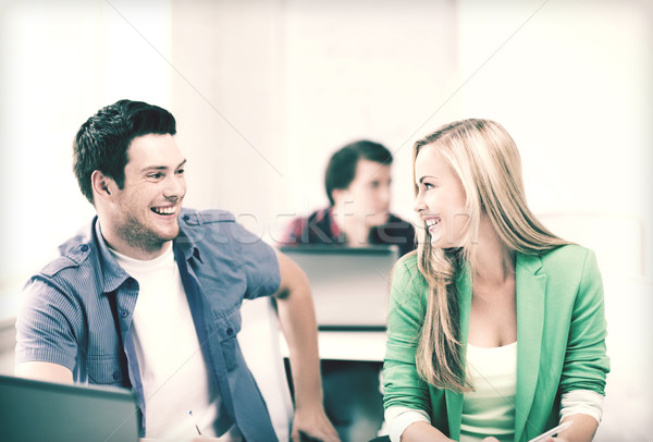 smiling students looking at each other at school Stock photo © dolgachov