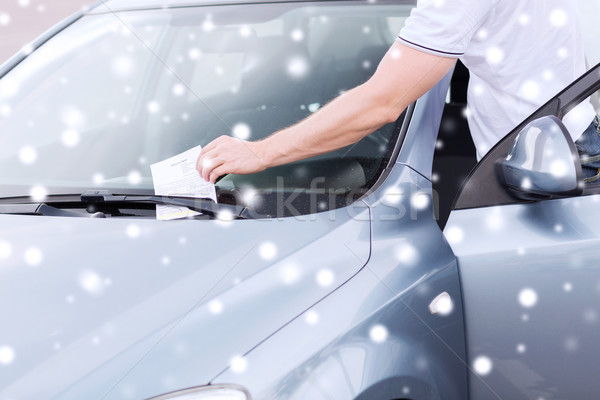 close up of man with parking ticket on car Stock photo © dolgachov