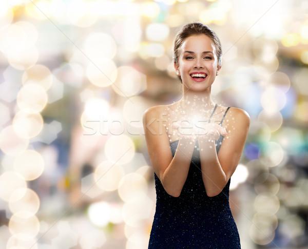 Risonho mulher vestido de noite algo férias Foto stock © dolgachov