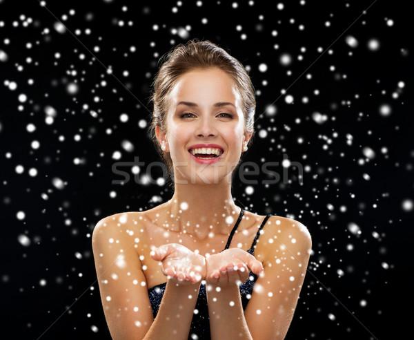 смеясь женщину вечернее платье что-то реклама Сток-фото © dolgachov