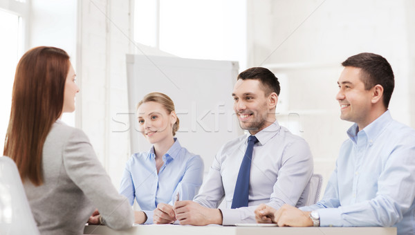 smiling businesswoman at interview in office Stock photo © dolgachov