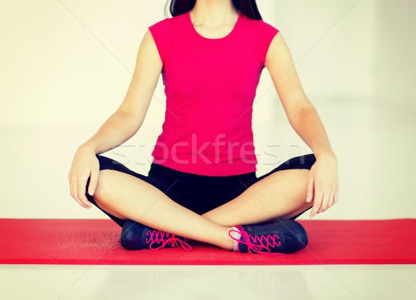 Lány ül lótusz pozició meditál sport Stock fotó © dolgachov