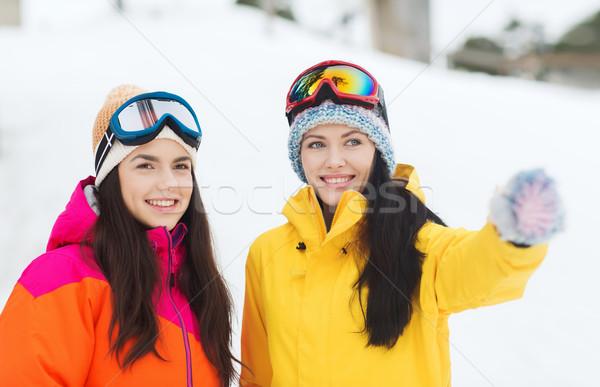 happy girl friends in ski goggles outdoors Stock photo © dolgachov