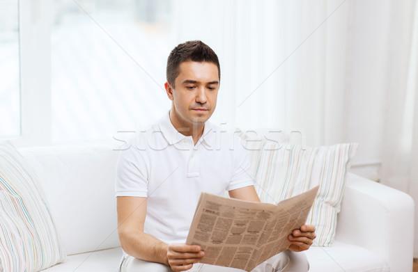 man reading newspaper at home Stock photo © dolgachov