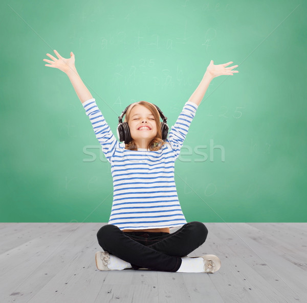 happy girl with headphones listening to music Stock photo © dolgachov
