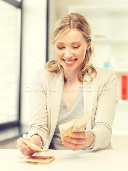 lovely woman counting euro cash money Stock photo © dolgachov