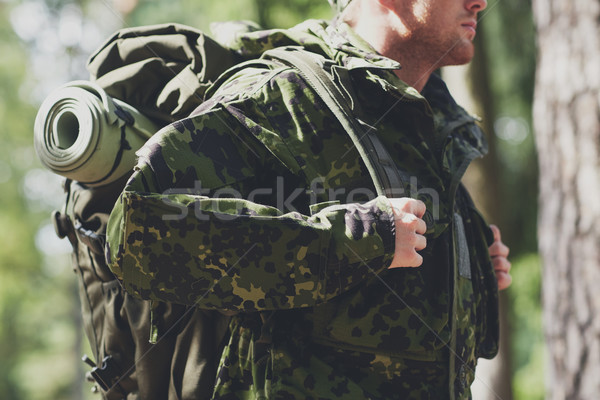 close up of young soldier with backpack in forest Stock photo © dolgachov