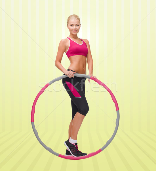 young sporty woman with hula hoop Stock photo © dolgachov