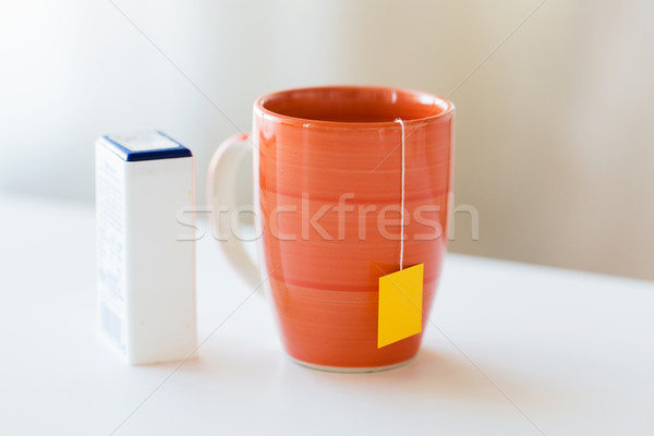 close up of sweetener and tea cup on table Stock photo © dolgachov