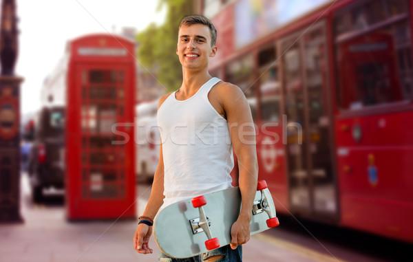 улыбаясь человека скейтборде Лондон городской улице отдыха Сток-фото © dolgachov