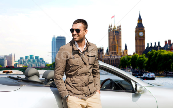 happy man near cabriolet car over london city Stock photo © dolgachov