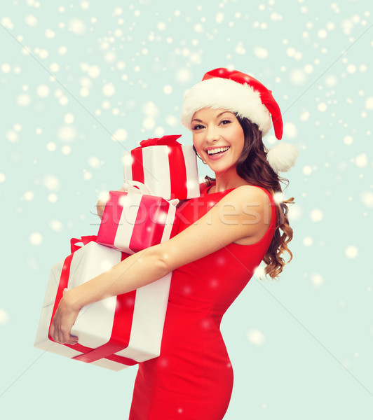 71a926834f0a7 woman in santa helper hat with many gift boxes Stock photo © dolgachov