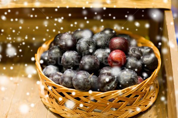 ripe plums in basket at farm or food market Stock photo © dolgachov