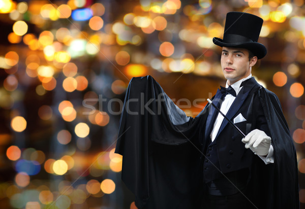 magician in top hat showing trick with magic wand Stock photo © dolgachov