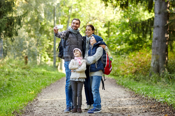 family taking selfie with smartphone in woods Stock photo © dolgachov