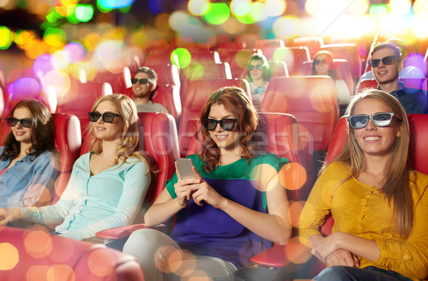 happy woman with smartphone in 3d movie theater Stock photo © dolgachov