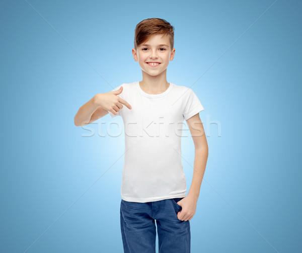 happy boy pointing finger to his white t-shirt Stock photo © dolgachov