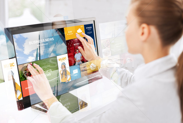 woman with web pages on touchscreen in office Stock photo © dolgachov
